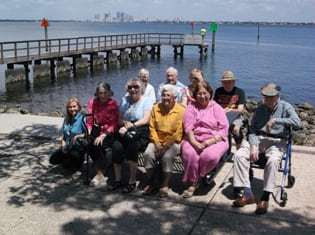 group of seniors sitting on a bench