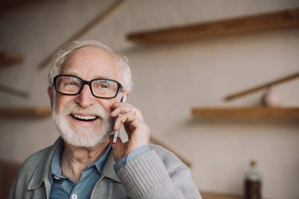 Senior man smiling and talking on cell phone