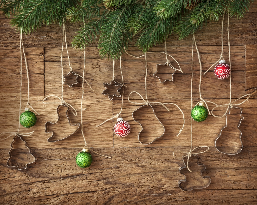Cookie cutters and baubles hanging from greenery
