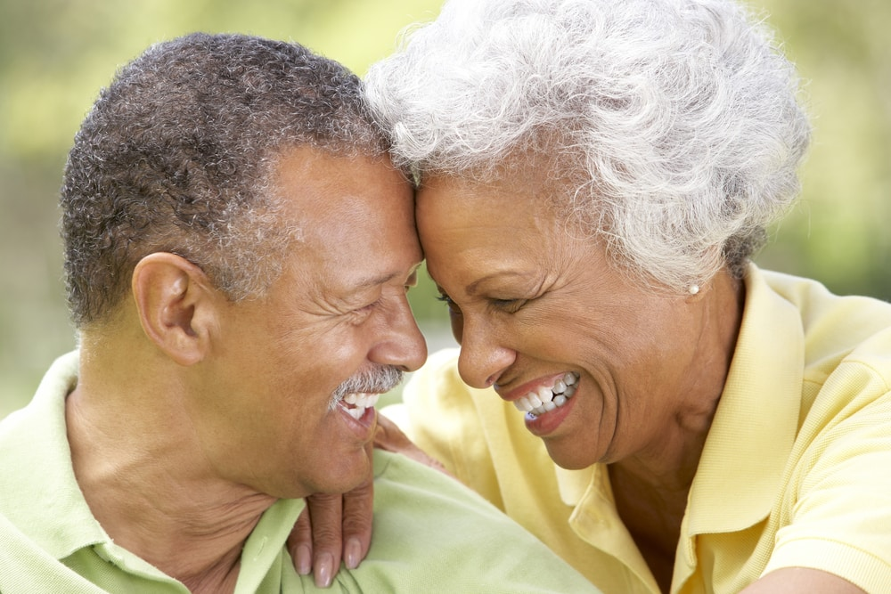 Senior couple smiling at each other outdoors