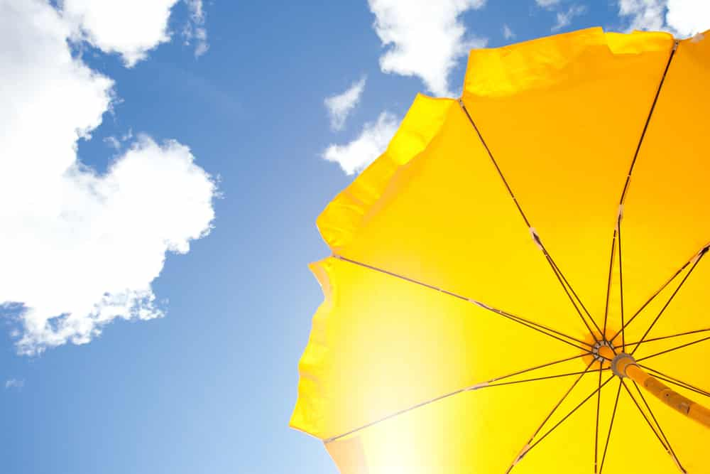 Yellow Beach Umbrella, Blue Sky with Clouds